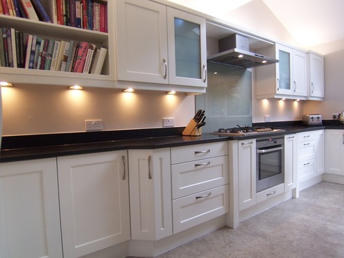 Shaker kitchen with angled cupboard door