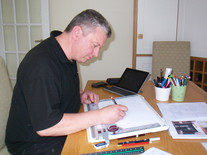 Designer at drawing board