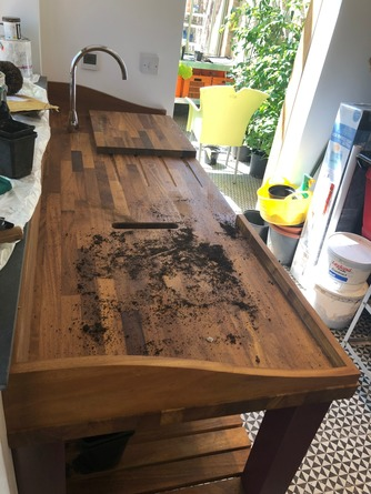 Solid iroko potting bench