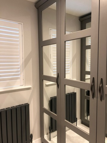 Fitted wardrobes with mirror doors