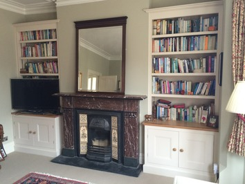Bespoke bookcases in alcoves
