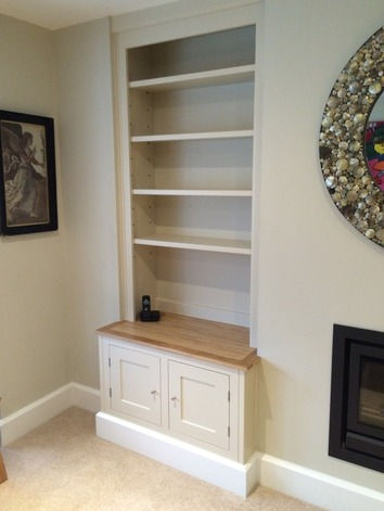 Built-alcove shelving and cupboard