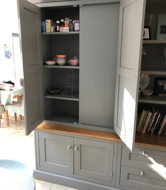 Dresser built around stone pillar