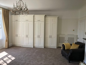 Built-in wardrobes and radiator cover